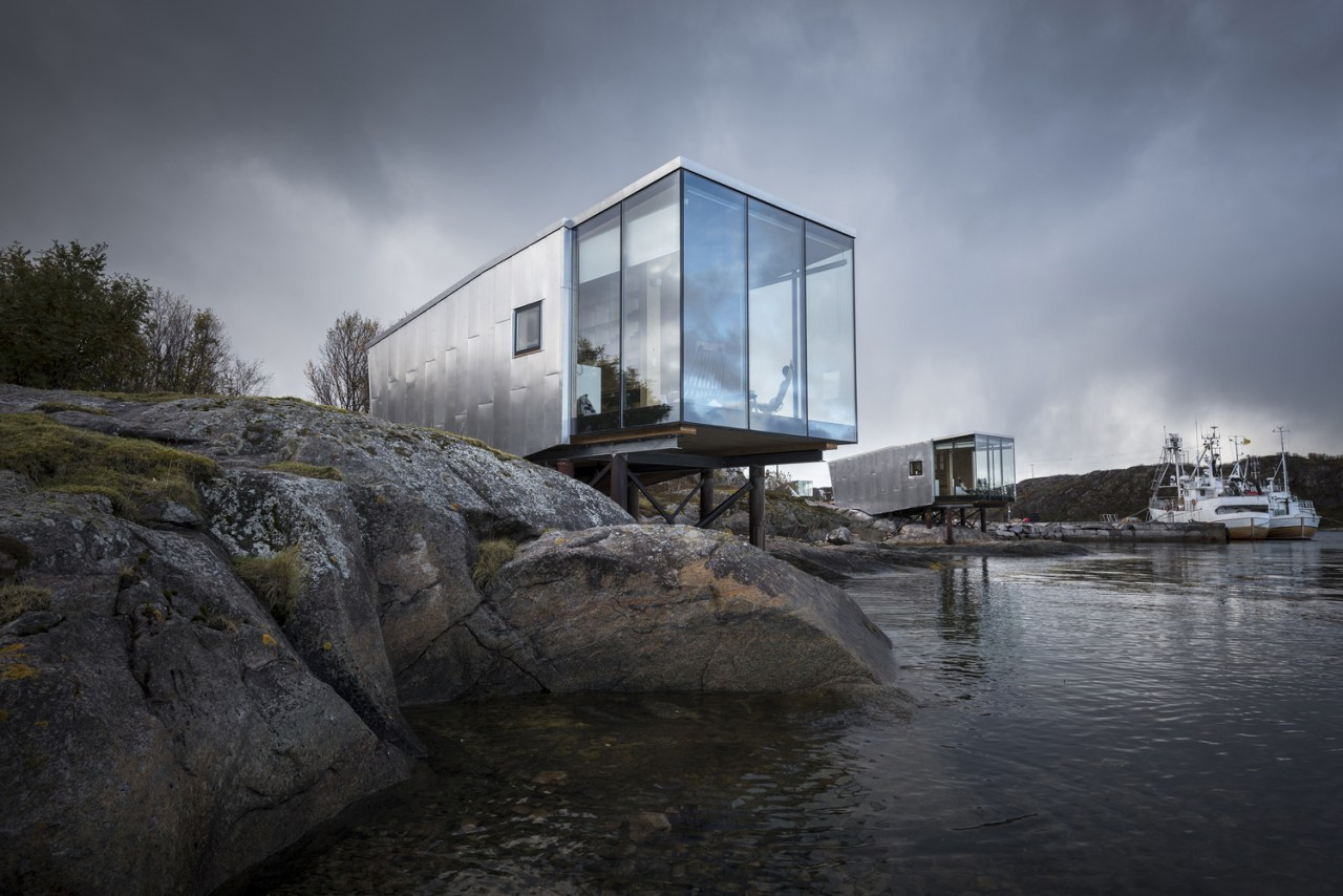 These cabins form part of an extension to architecture, cloud, house, reflection, sky, tree, water, gray, black