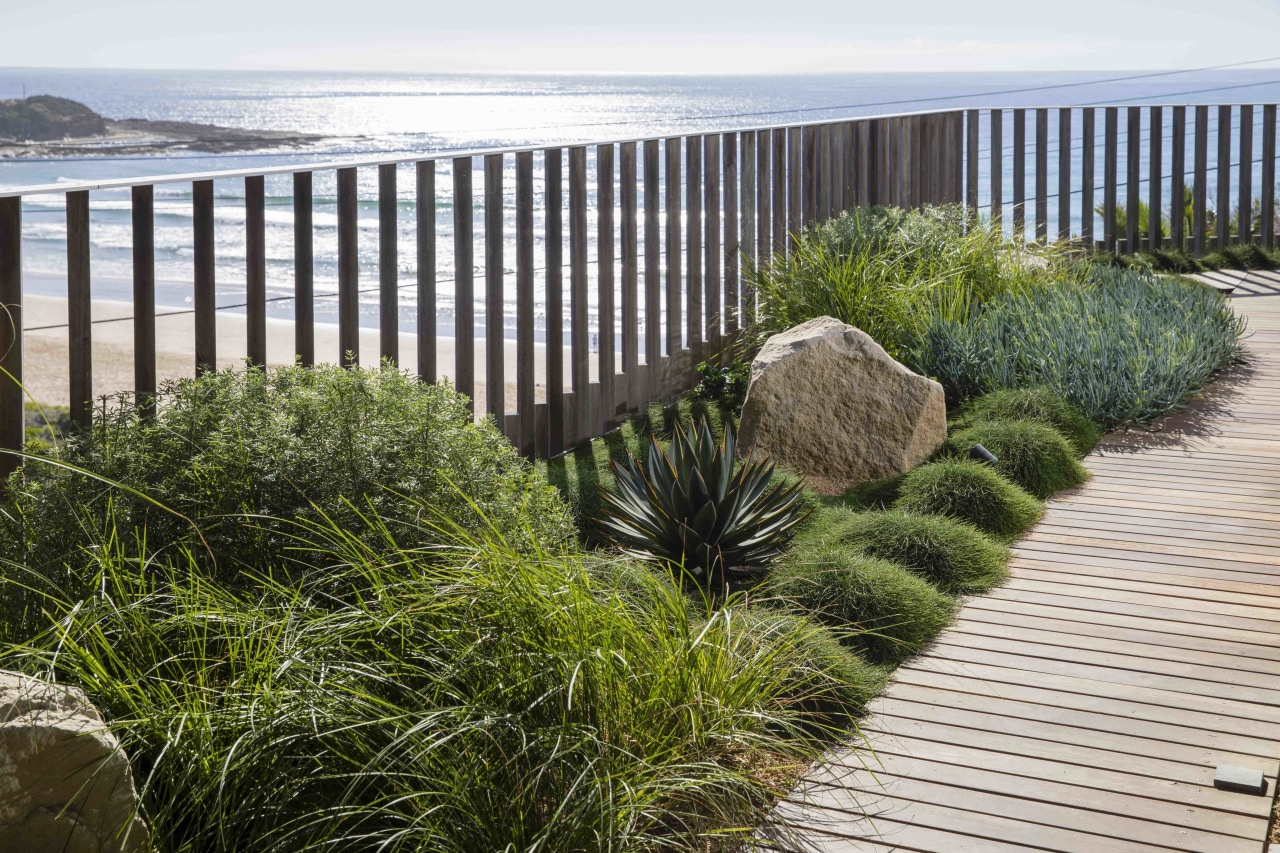 Think about the style you want your green deck, fence, garden, grass, grass family, handrail, home fencing, landscape, landscaping, natural landscape, plant, rock, shrub, tree, walkway, wall, yard, white, brown