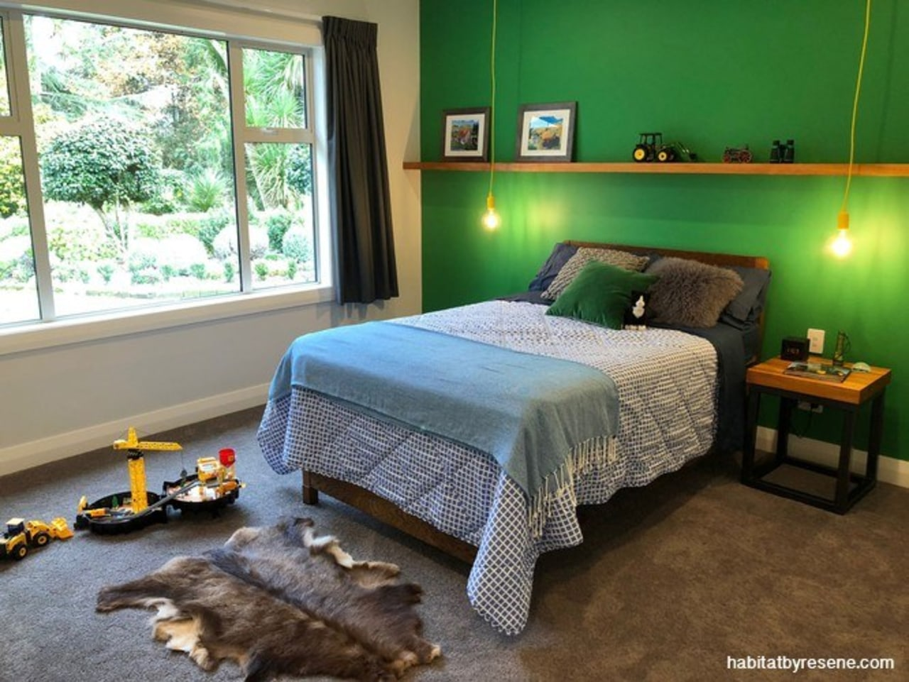 Five-year-old Tom wanted to bring the John Deere bed, bed frame, bed sheet, bedding, bedroom, building, ceiling, duvet cover, floor, flooring, furniture, green, hardwood, home, house, interior design, linens, mattress, nightstand, property, real estate, room, textile, wall, wood, green