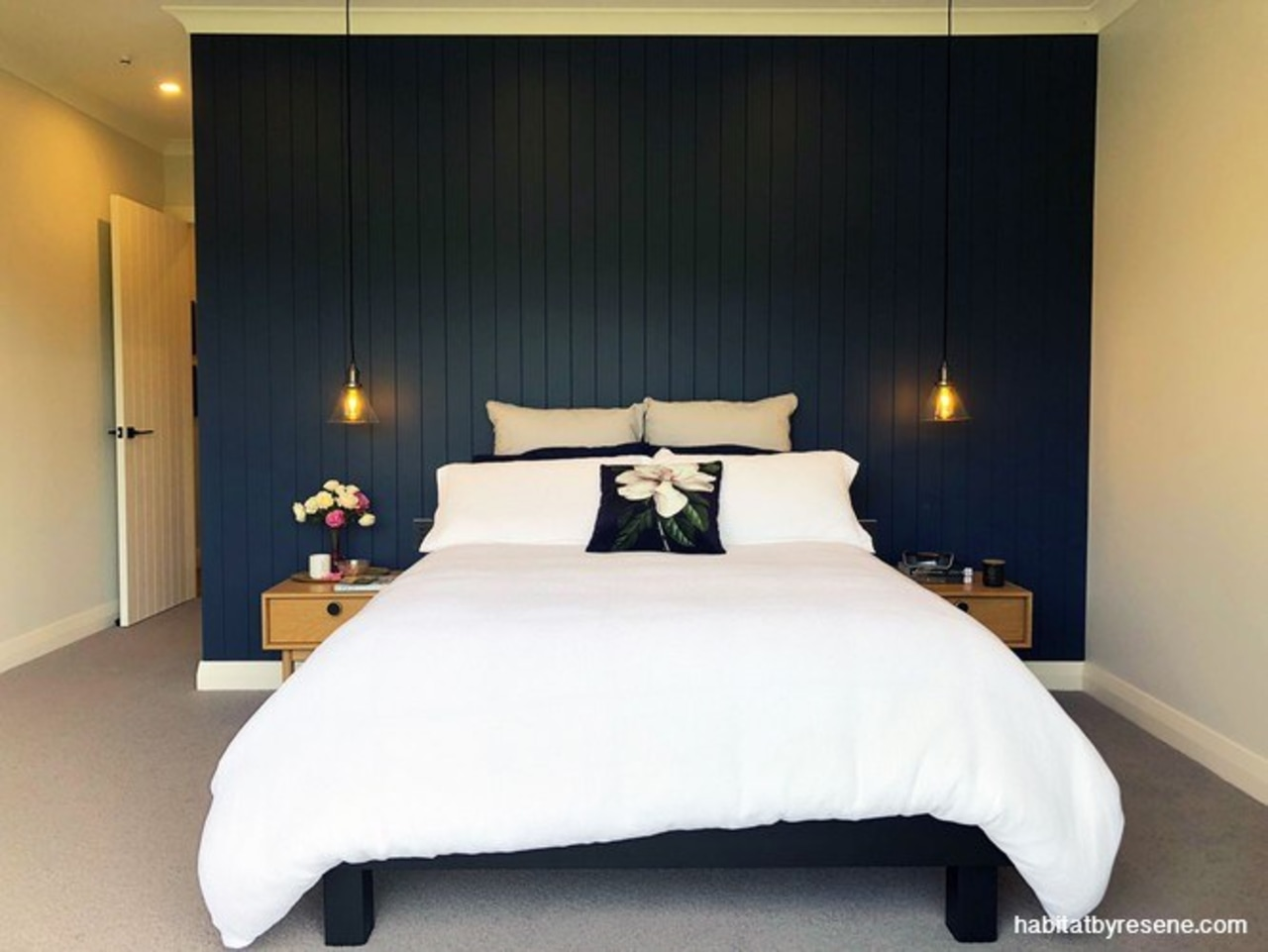 Gemma chose Resene Dark Side for the feature bed, bed frame, bed sheet, bedding, bedroom, boutique hotel, building, ceiling, comfort, design, duvet cover, floor, furniture, interior design, lighting, linens, mattress, mattress pad, property, real estate, room, suite, textile, wall, black, white