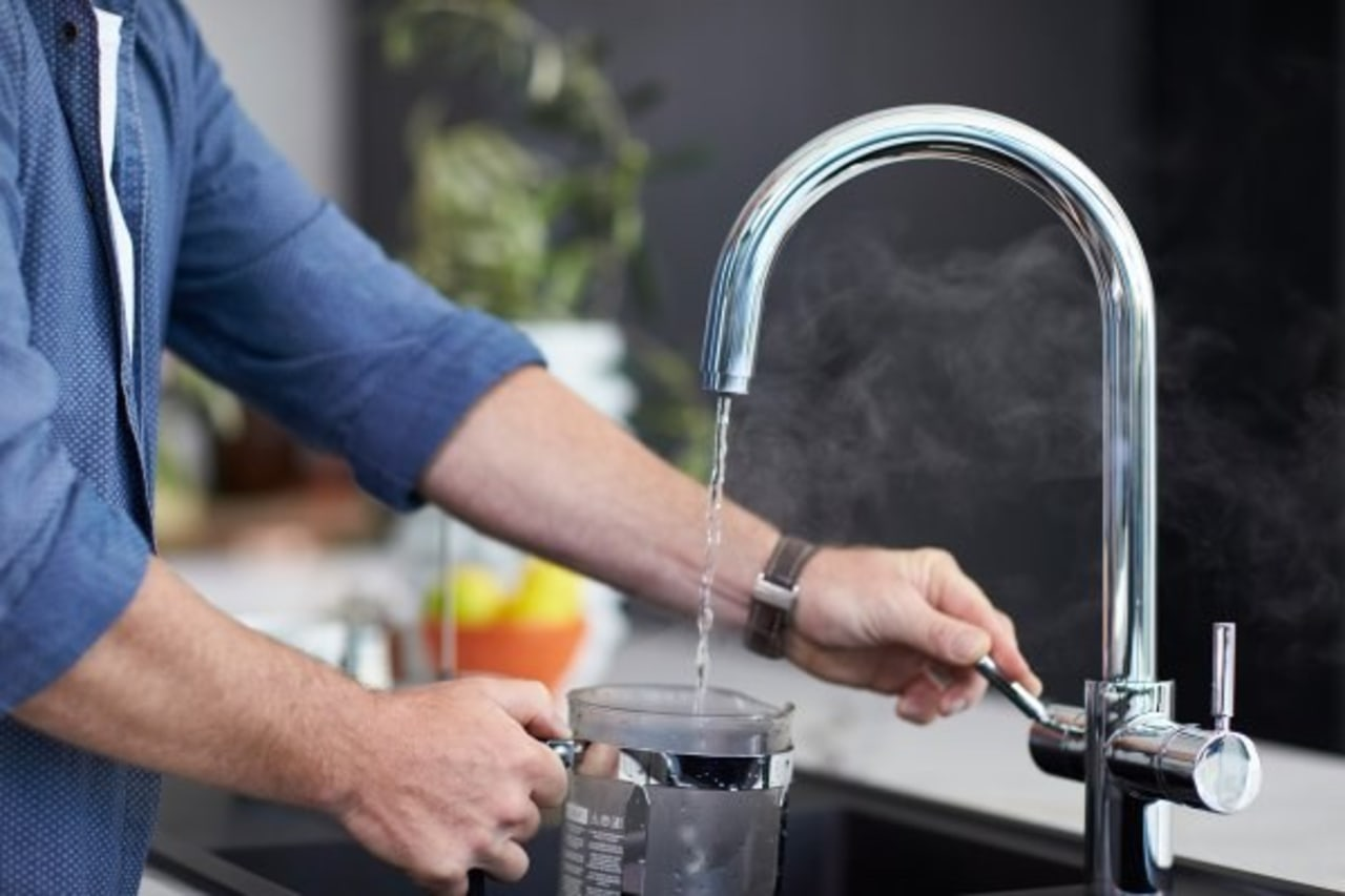 Get instant access to near-boiling water, as well drink, product, small appliance, water, black
