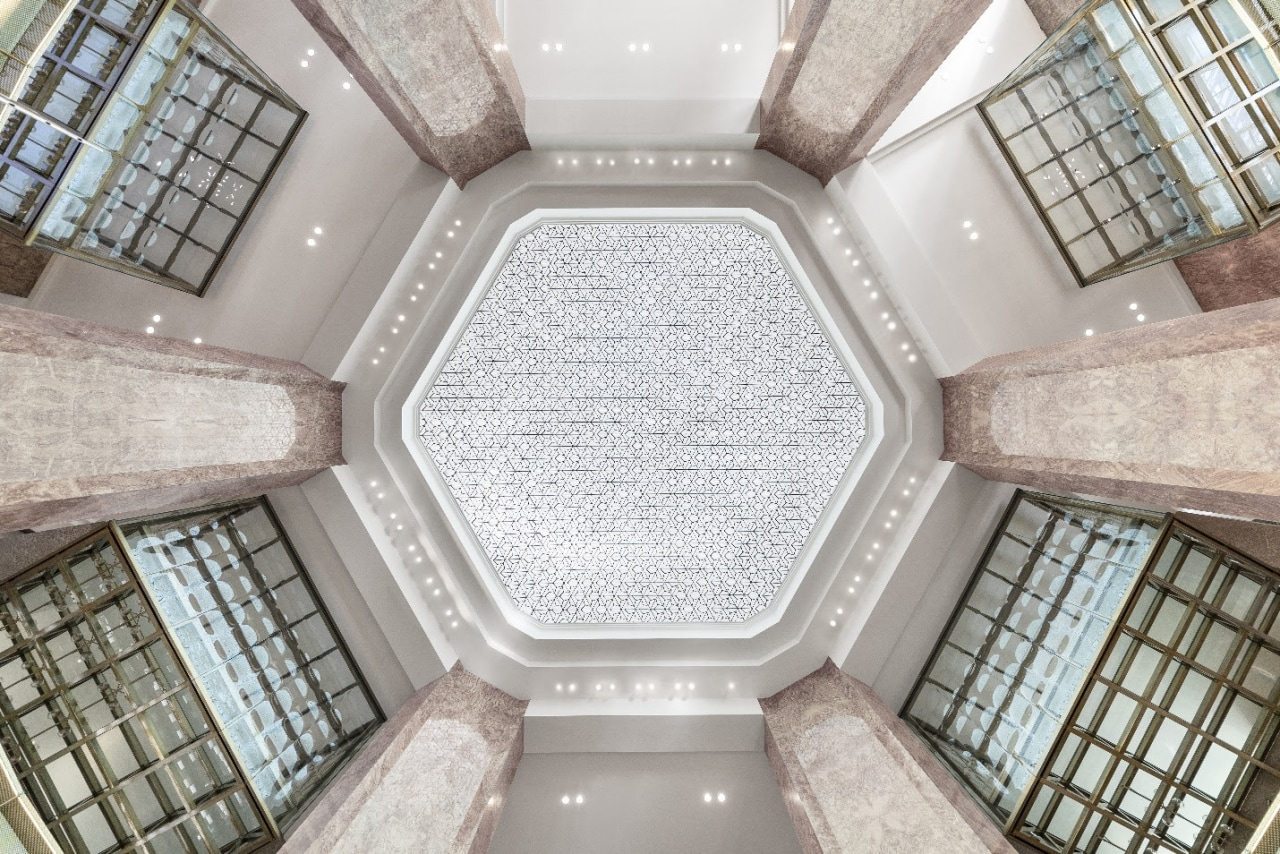 Throughout the store, visitors encounter precious materials and architecture, building, ceiling, daylighting, interior design, line, property, room, symmetry, gray
