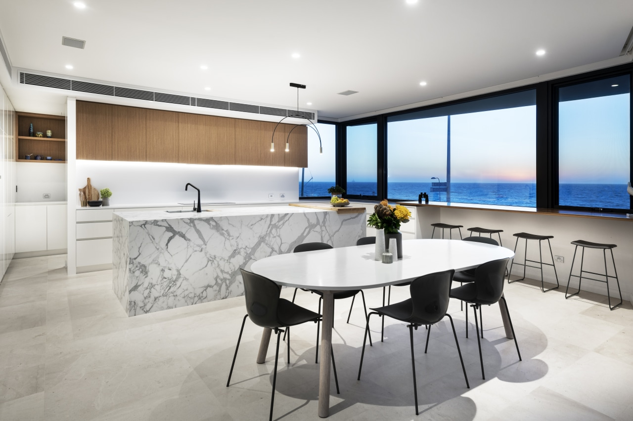 This kitchen offers both a focal point and architecture, building, cabinetry, ceiling, chair, countertop, design, dining room, floor, flooring, furniture, home, house, interior design, kitchen, living room, property, real estate, room, table, wall, white