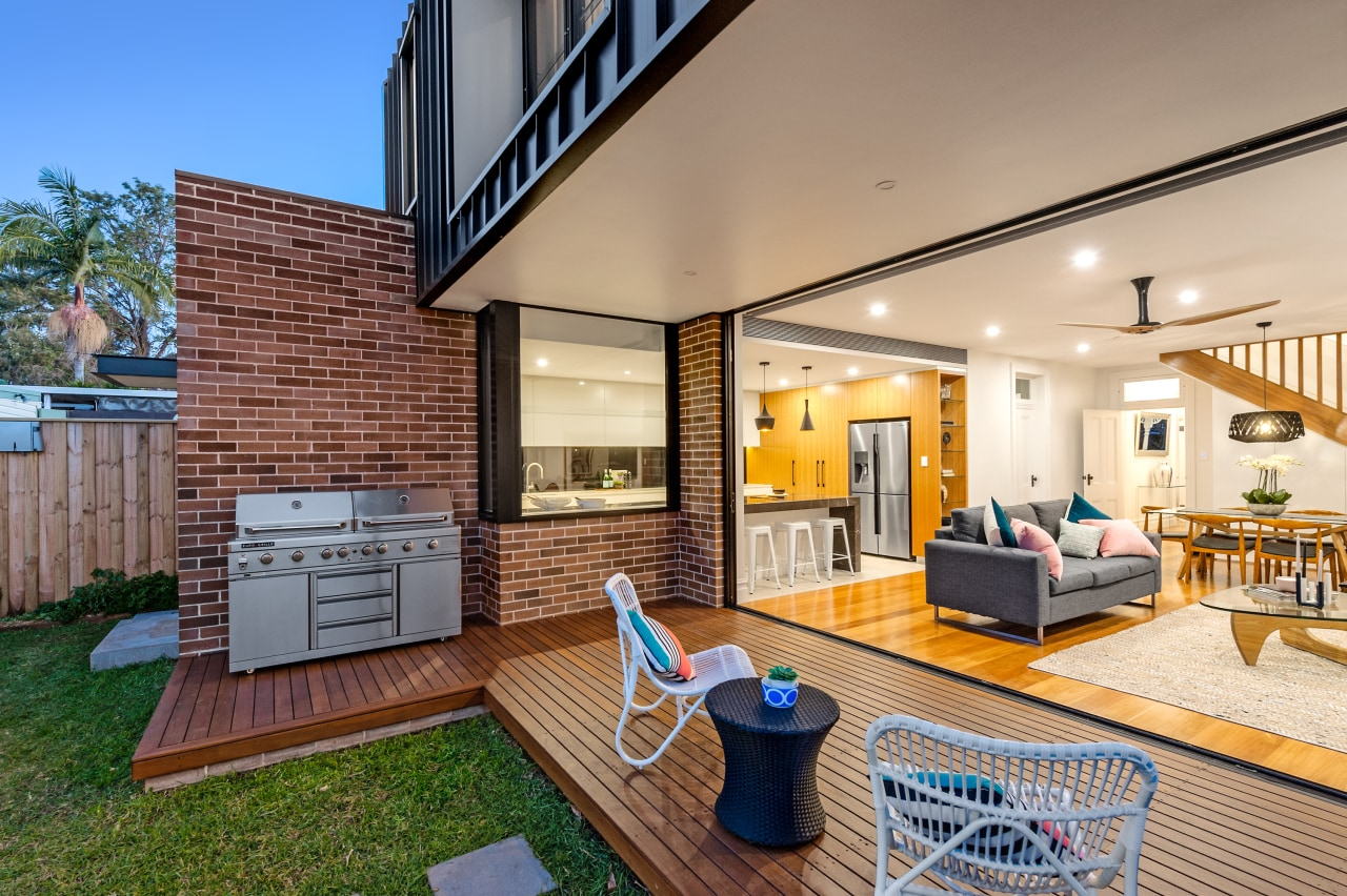 The ground floor includes open-plan kitchen, living and estate, home, house, interior design, living room, patio, penthouse apartment, property, real estate, orange