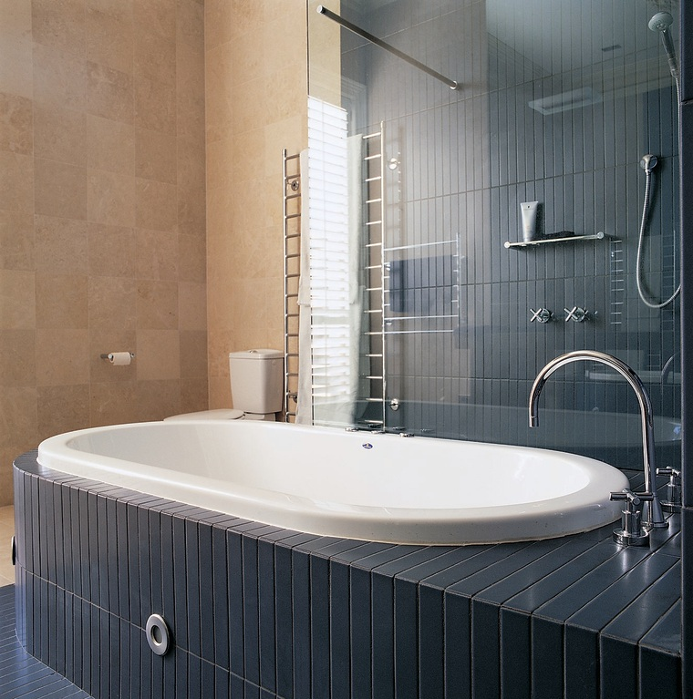 The bathtub of this well-designed bathroom... bathroom, bathroom cabinet, bathtub, floor, interior design, plumbing fixture, room, tap, tile, wall