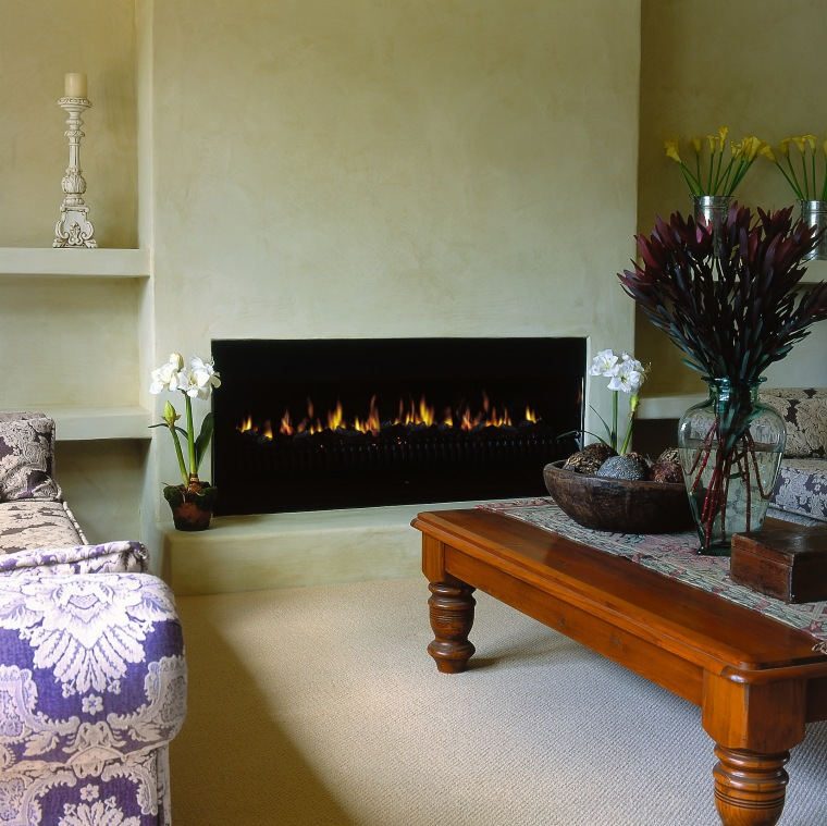 View of the heating in this living room fireplace, flooring, furniture, hearth, home, interior design, living room, room, table, brown, gray