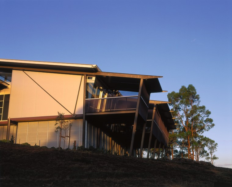 Side view of the house. Includes steel panels architecture, building, cottage, facade, home, house, real estate, roof, siding, sky, blue, black