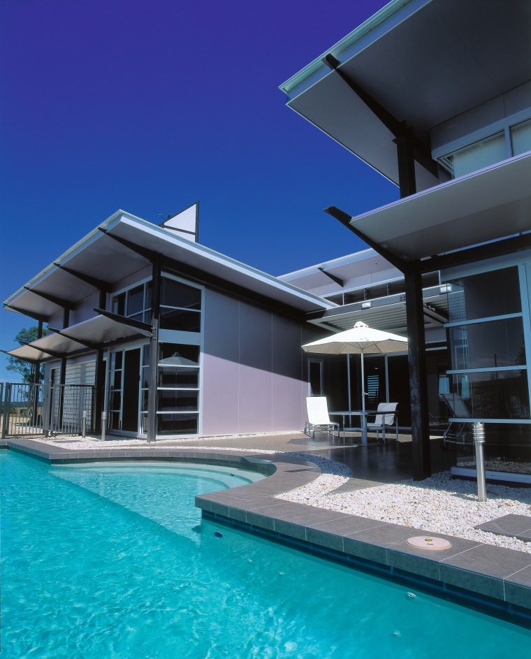 The pool & garage at the back of architecture, building, condominium, estate, facade, home, house, property, real estate, resort, sky, swimming pool, villa, water, blue, black, teal