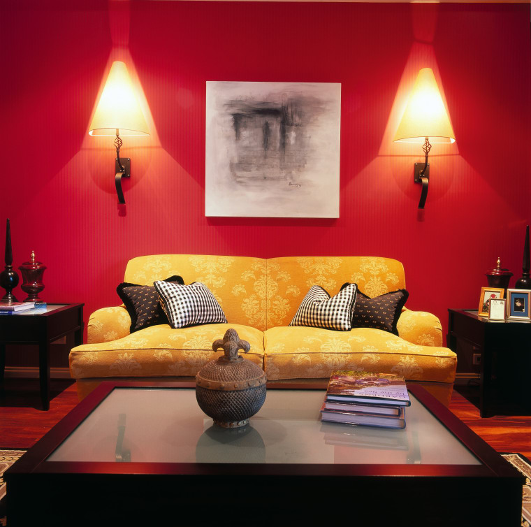 View of a living area with two large ceiling, couch, furniture, interior design, living room, orange, room, suite, table, wall, red