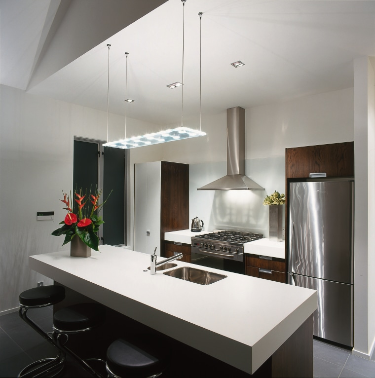 A kitchen featuring an Itailan styled pendant above countertop, interior design, kitchen, product design, gray, white, black