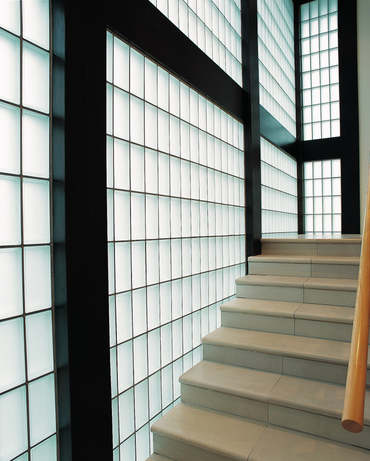 A stairway featuring a glass block wall. There architecture, building, daylighting, facade, glass, line, structure, wall, window, white, black