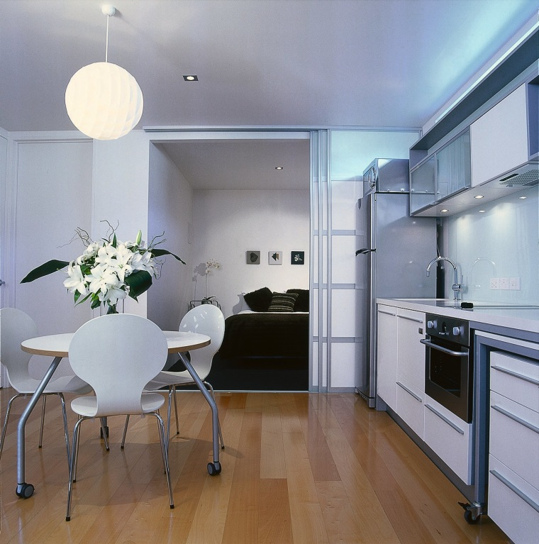 A photograph of a kitchen and dining area. apartment, ceiling, countertop, floor, flooring, interior design, kitchen, real estate, room, gray