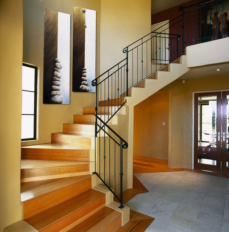 The entrance & stairway of this magnificant home baluster, floor, flooring, handrail, hardwood, interior design, laminate flooring, stairs, structure, wood flooring, brown