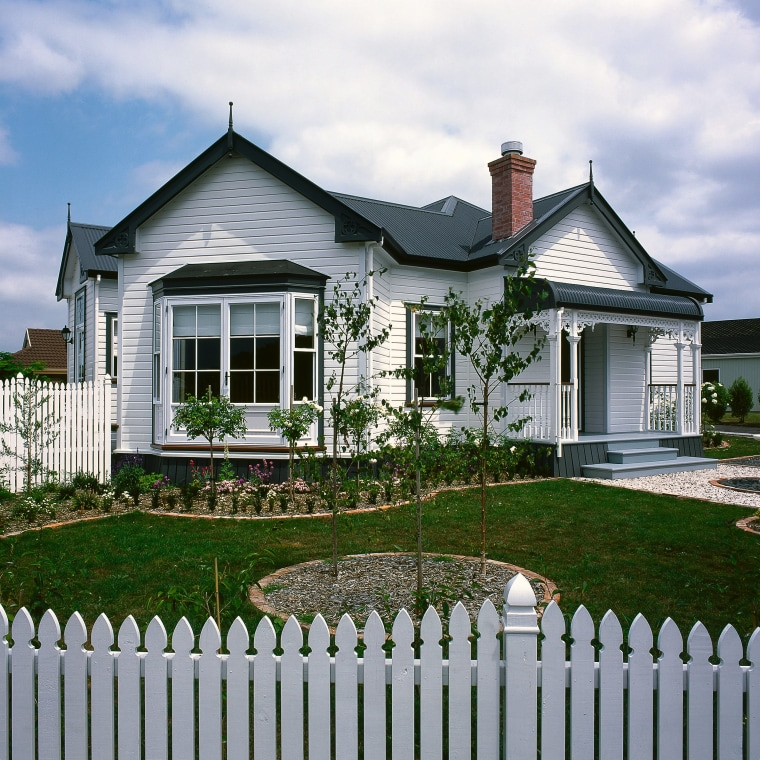View of this classical hit cottage, elevation, estate, facade, farmhouse, fence, home, home fencing, house, landscaping, neighbourhood, outdoor structure, picket fence, property, real estate, residential area, siding, window, yard, gray