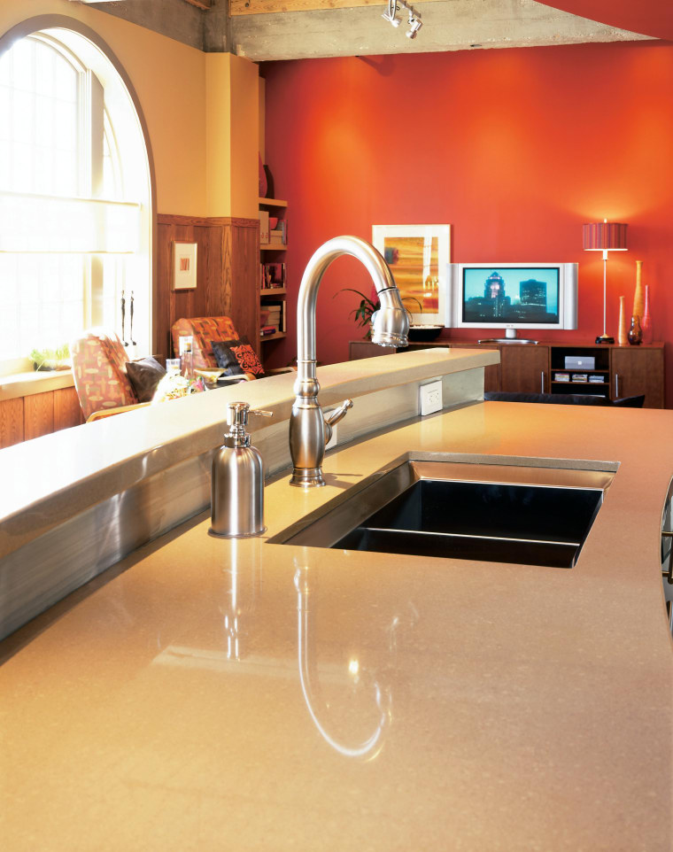 View of the kitchen area of this home countertop, floor, flooring, furniture, interior design, kitchen, room, table, orange