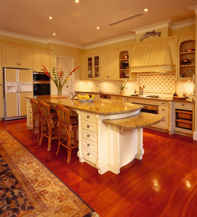 View of the kitchen area cabinetry, countertop, cuisine classique, floor, flooring, furniture, hardwood, interior design, kitchen, laminate flooring, room, wood, wood flooring, orange, red
