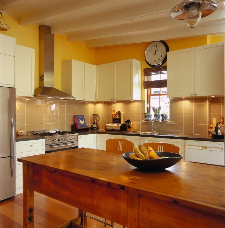 View of this kitchen area cabinetry, ceiling, countertop, cuisine classique, floor, flooring, hardwood, interior design, kitchen, real estate, room, under cabinet lighting, wood flooring, brown, orange