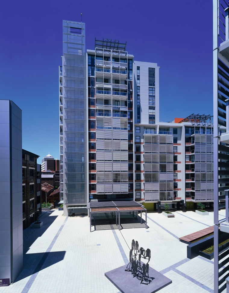 View of apartment and retail complex from paved apartment, architecture, building, city, commercial building, condominium, corporate headquarters, daytime, elevation, facade, headquarters, metropolis, metropolitan area, mixed use, neighbourhood, real estate, residential area, sky, skyscraper, tower block, urban area, urban design, blue