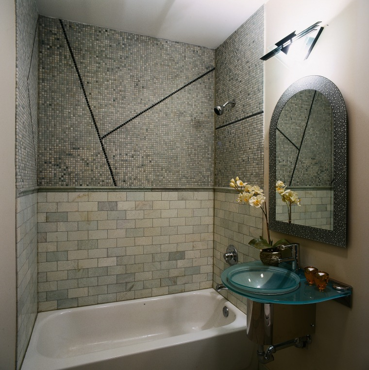 View of this bathroom bathroom, floor, flooring, interior design, plumbing fixture, room, tile, wall, gray, black