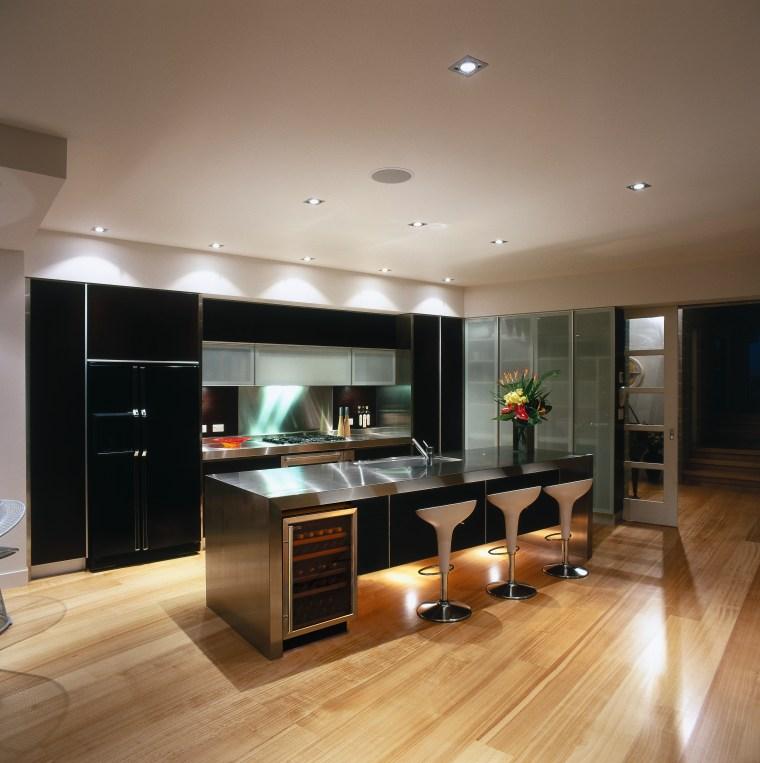 interior view showing cooling storage cabinets cabinetry, countertop, floor, flooring, hardwood, interior design, kitchen, laminate flooring, living room, room, wood flooring, brown