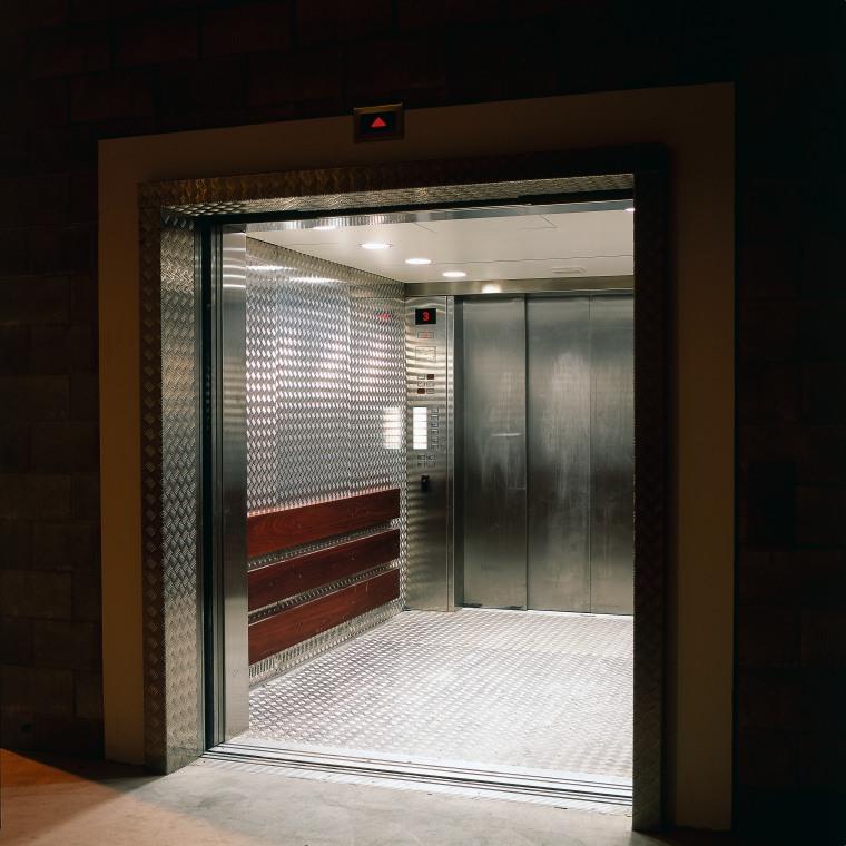 Service lift with heavy gauge aluminium chequer plate door, black