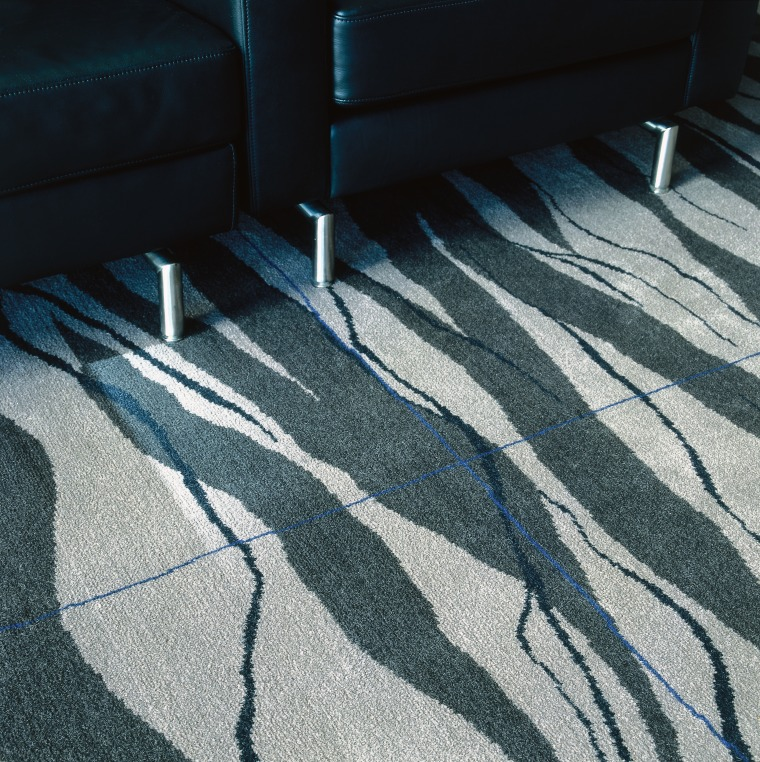Patterned carpet with grid pattern, and black chairs. angle, blue, carpet, floor, flooring, line, road surface, shadow, wood, black