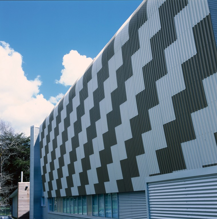 Exterior of building showing patterned design of steel architecture, building, commercial building, corporate headquarters, daylighting, daytime, facade, headquarters, landmark, metropolitan area, residential area, roof, sky, skyscraper, structure, tower block, teal, black