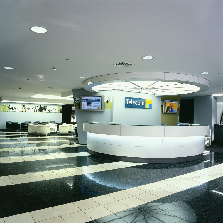 Large white reception desk with flat tv screens infrastructure, product design, gray