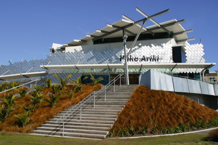 Exterior view of entrance way to Puke Ariki, architecture, building, roof, structure, brown, blue