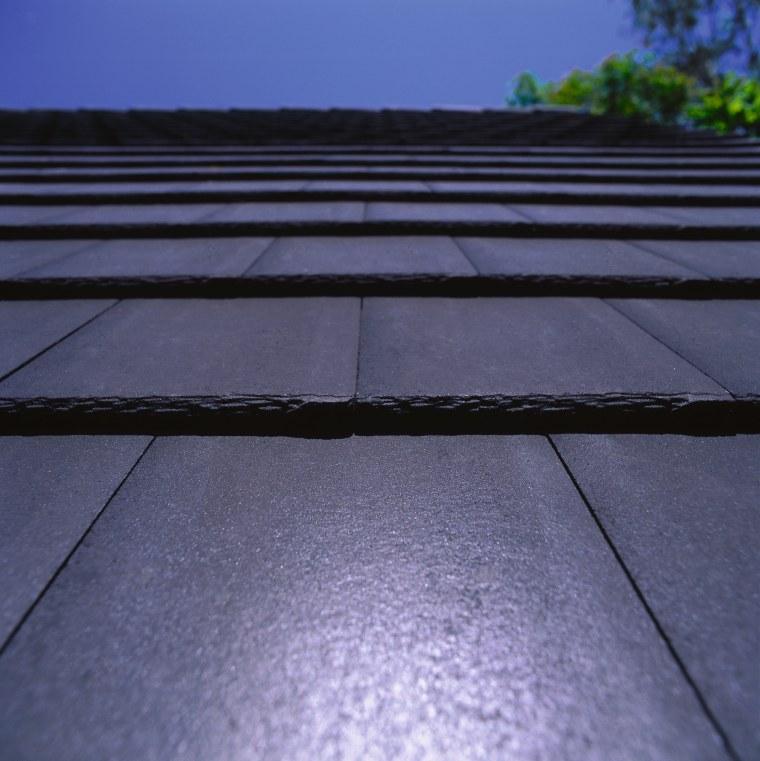 Closeup of Monier shingle roof tiles in dark asphalt, daylighting, horizon, light, line, road surface, roof, sky, sunlight, blue