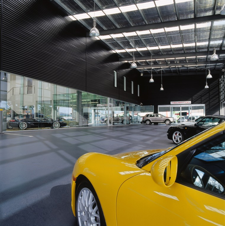 view of the canopy looking into the showroom, auto show, automotive design, automotive exterior, car, land vehicle, luxury vehicle, motor vehicle, performance car, sports car, supercar, vehicle, yellow, black, gray