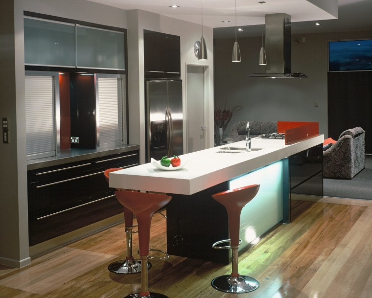 A view of a kitchen, wooden flooring, bar cabinetry, countertop, interior design, kitchen, room, black, gray