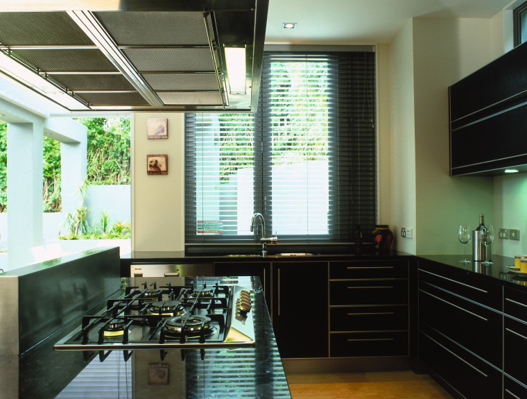 A view of a kitchen area, wooden cabinetry ceiling, countertop, interior design, kitchen, room, window, black