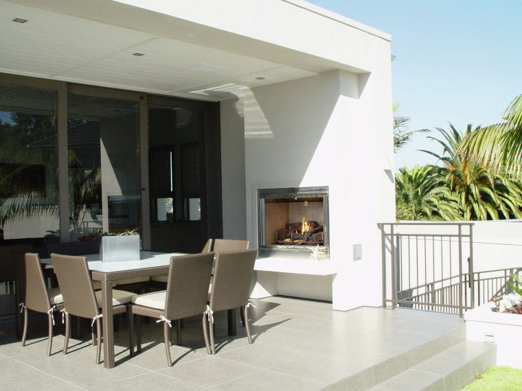 view of the outdoor gas fire located in floor, house, interior design, living room, property, real estate, window, white