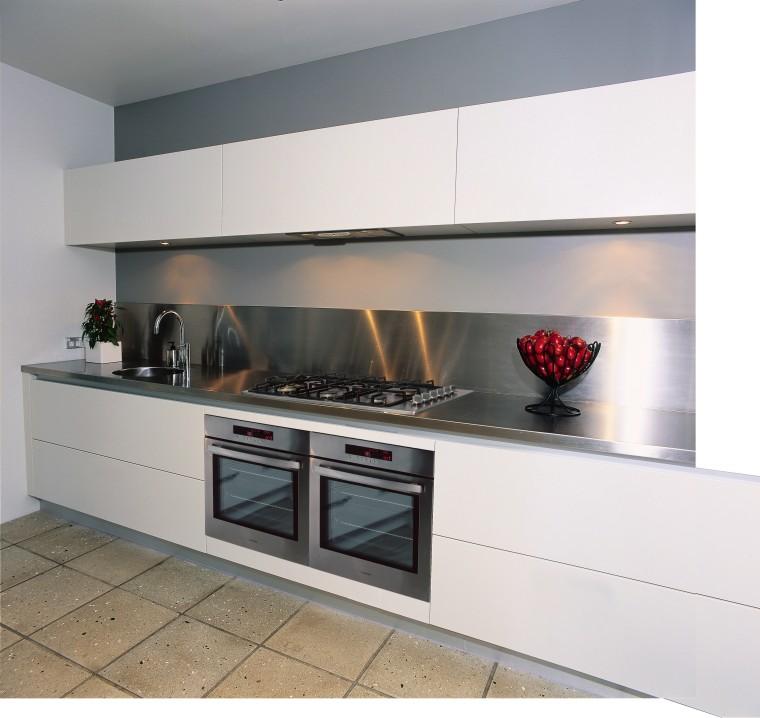 A view of a kitchen area, grey concrete countertop, gas stove, home appliance, kitchen, kitchen appliance, kitchen stove, white, gray