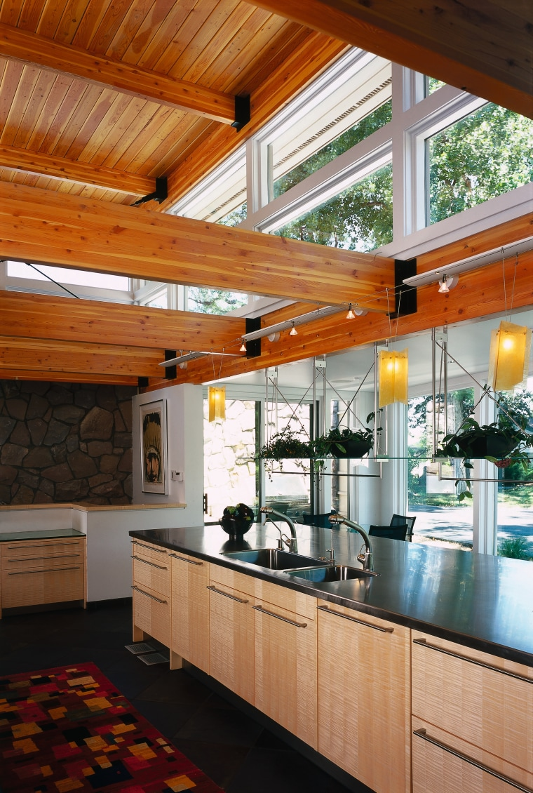 view of the stainless steel countertop and light architecture, ceiling, countertop, daylighting, house, interior design, kitchen, real estate, window, wood, brown