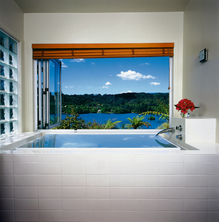 The Kohler Sok bath at the Pukeko Landing bathroom, bathtub, estate, home, interior design, property, room, swimming pool, wall, window, gray