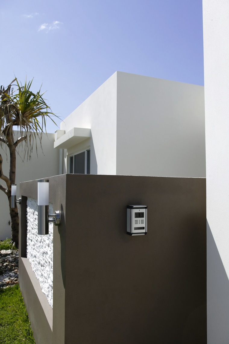 this unobtrusive camera, part of an infrared intercom architecture, building, facade, home, house, real estate, black, white