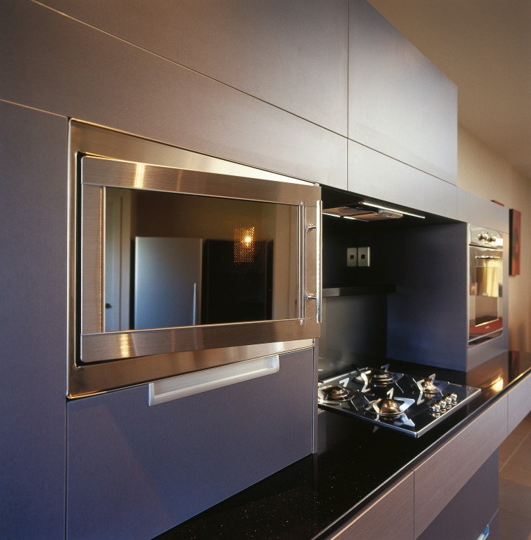 An example of the different appliances offered by cabinetry, countertop, interior design, kitchen, gray, black, brown