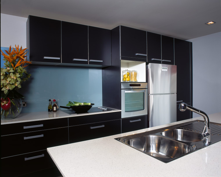 Virtuoso provide appliances to ensure the kitchen area cabinetry, countertop, interior design, kitchen, room, black, gray