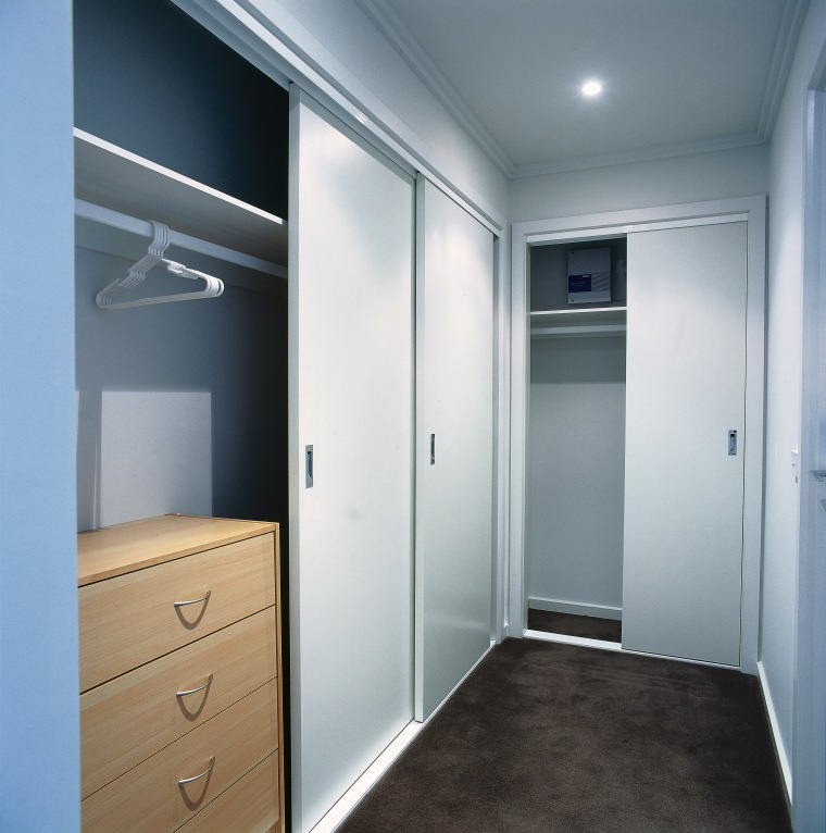 View of wardrobe system in apartment. closet, door, real estate, room, wardrobe, gray