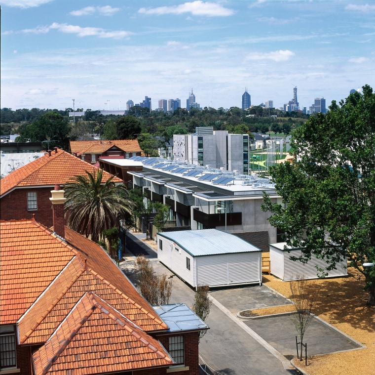 Overhead view of roofs at the Athletes' Village architecture, city, home, house, neighbourhood, outdoor structure, real estate, residential area, roof, sky, suburb, tree, white