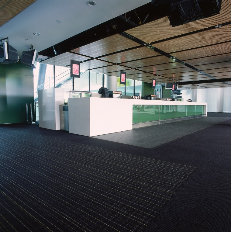Large foyer lounge area at the MCG with architecture, daylighting, floor, flooring, glass, interior design, structure, black