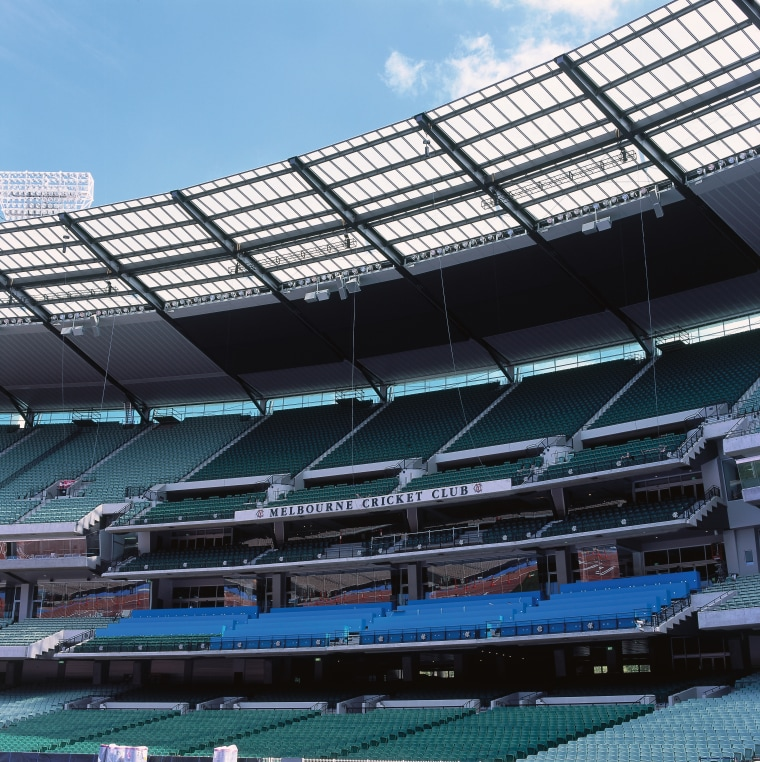 Large sports stadium at the MCG with partially arena, sport venue, stadium, structure, black, teal