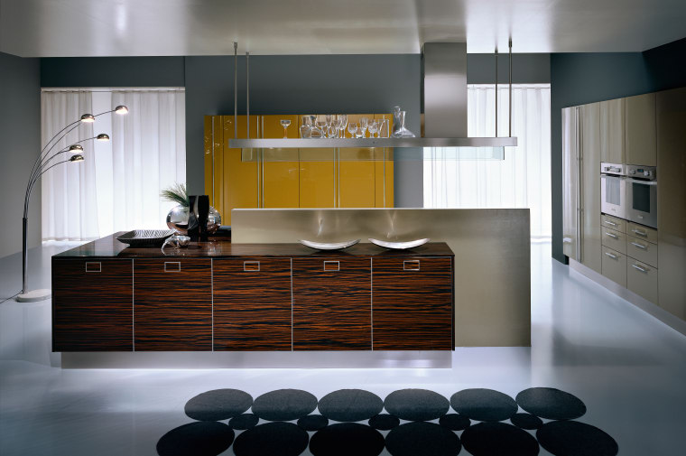 A view of a Pedini kitchen with brown cabinetry, countertop, cuisine classique, floor, flooring, interior design, kitchen, product design, room, gray, black