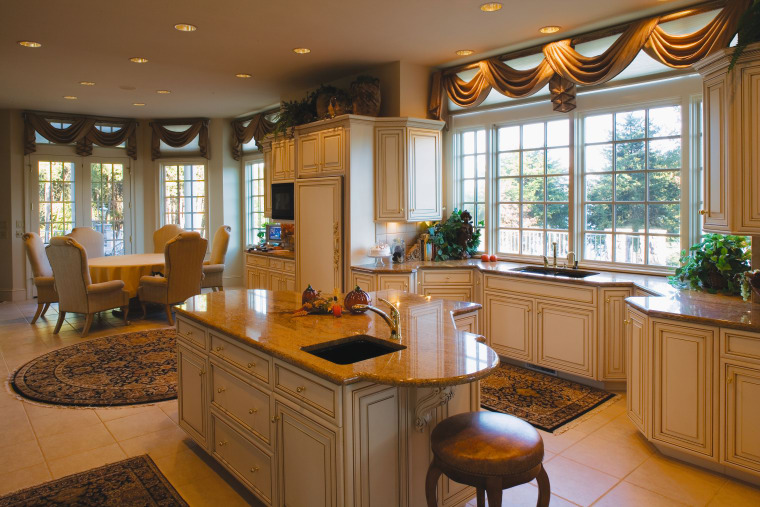 Open plan traditional style kitchen with cream cabinetry, cabinetry, countertop, cuisine classique, interior design, kitchen, real estate, room, window, brown
