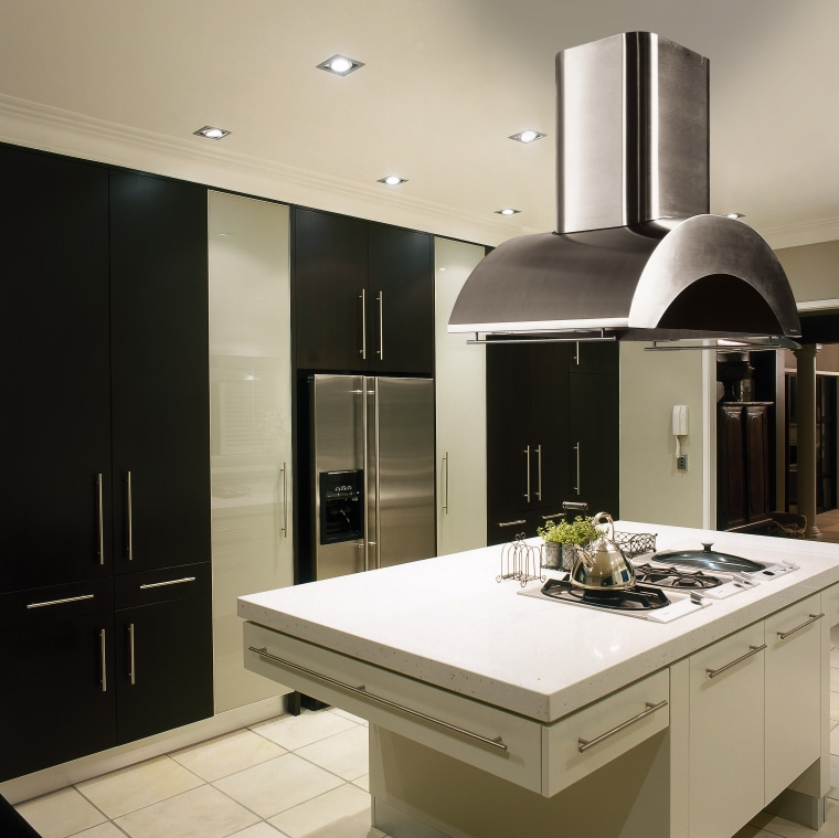 Kitchen with black and white cabinetry, white island countertop, home appliance, interior design, kitchen, gray, black