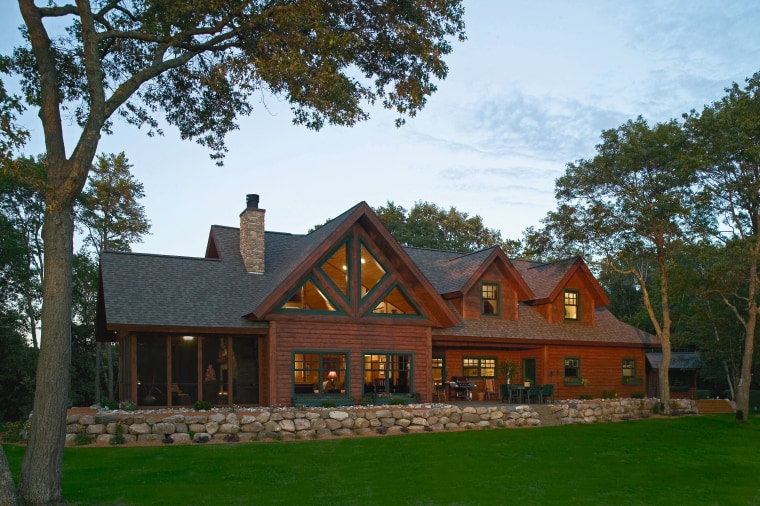 Exterior view of rustic style home. cottage, estate, facade, farmhouse, home, house, log cabin, mansion, property, real estate, roof, tree, brown