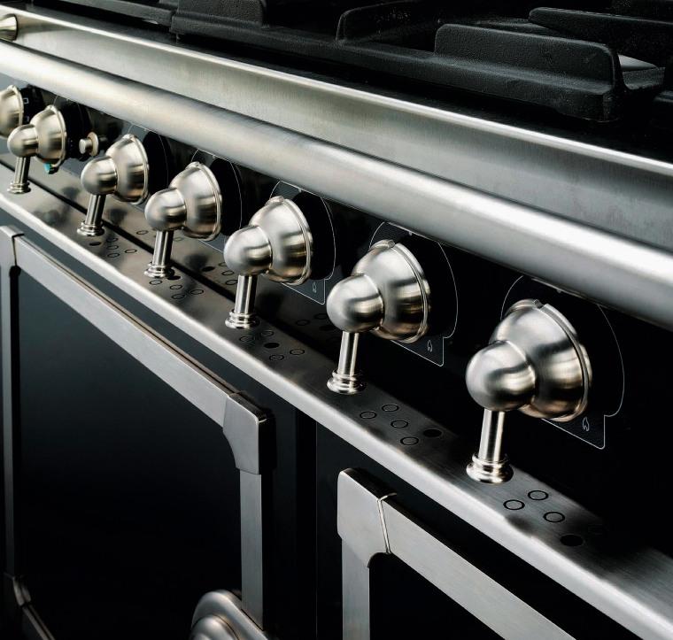 Closeup view of cooker control handles. automotive design, car, metal, motor vehicle, black, gray