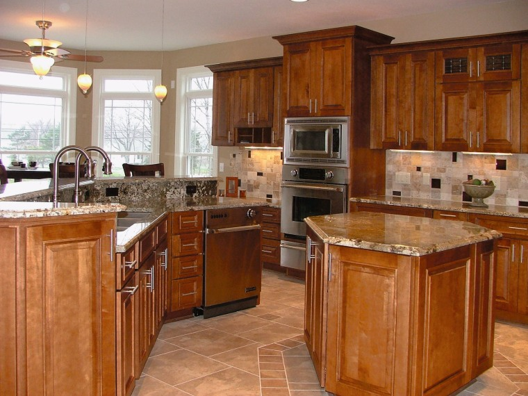 Kitchen with timber cabinetry, granite countertops, stainless steel cabinetry, countertop, cuisine classique, floor, flooring, hardwood, home, interior design, kitchen, room, wood, wood flooring, wood stain, brown